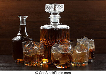 Glass whiskey on dark eight - Glass and bottle whiskey on...