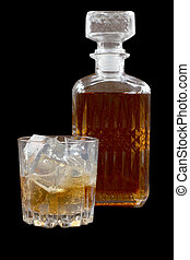 Glass whiskey on dark one - Glass and bottle whiskey on...