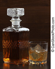 Glass whiskey on dark six - Glass and bottle whiskey on...