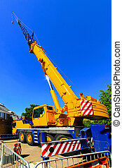Construction crane - Big and yellow construction crane for...