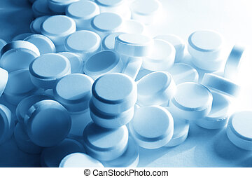 white pills - extreme close up with white medicines