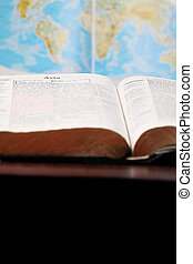 World Missions - Bible open to the Book of Acts the book...