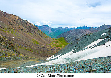 On a mountain pass, Kyrgyzstan. - On a rocky snow-covered...