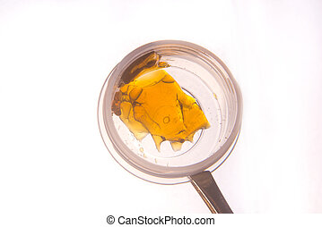 Piece of cannabis oil concentrate aka shatter used by...
