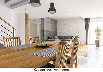 Dining room with communal table open to living room