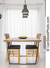 Communal table with chairs - Interior with wooden communal...