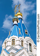 Blue domes with golden crosses of orthodox church against...