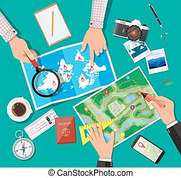 Table with paper map. Planning trip