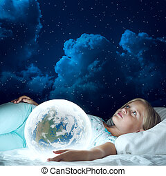 Girl in her bed and glowing globe - Cute girl in bed and...