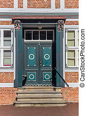 Decorated door of a historical house in Stade, Germany