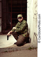 Lazy soldier on sentry duty in city guarding building -...