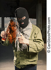 Extremist with flammable bomb burning bottle - Anarchist in...