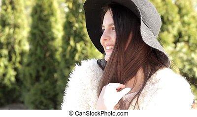 Girl posing at camera and smiling
