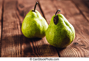 Two Pear on Wooden Background.