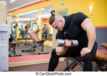 Closeup of a bodybuilder working out at gym