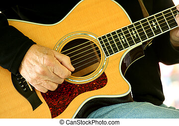 Man strumming guitar - A Man strumming guitar
