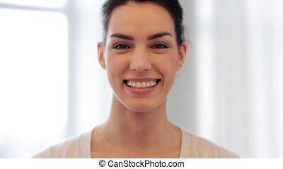 happy smiling young woman with braces - people, expression...