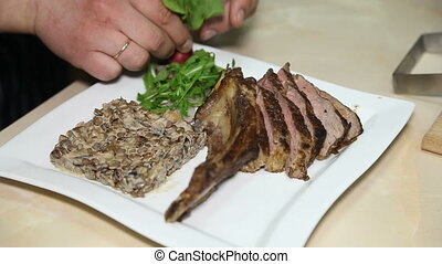 Cook cooks a dish of fried meat - The chef prepares a dish...