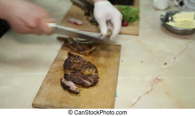 Chef regulates roast meat - The chef regimen pork fried meat...