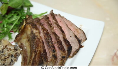 Dish with roast meat with garnish - Dish with sliced roast...