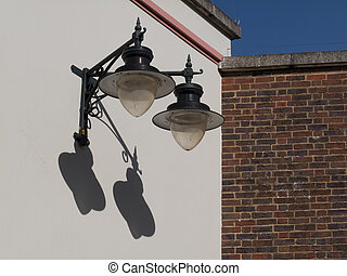 Street Lamps - Vintage style street lamps fixed to side of...