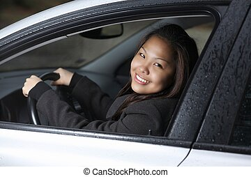 Young woman driving her new car