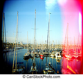 One red boat in Barcelona Spain. - A stock photograph of a...