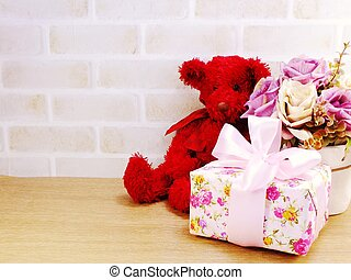cute teddy bear doll with gift box and flowers with copy...