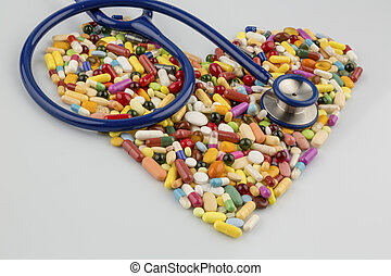 stethoscope and pills in heart shape - stethoscope and pills...