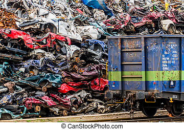 cars were scrapped - old cars were scrapped in a trash...