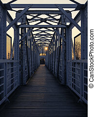 Symmetry view of footbridge over railway track at sunset....