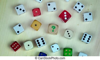 Colorful dices on wooden background. turntable - Colorful...