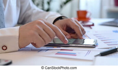 Businessman Using Mobile Phone With Growth Graph Chart And...