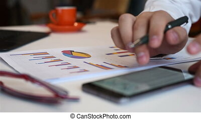 Businessman Analyzing Stock Diagrams - Businessman Analyzing...