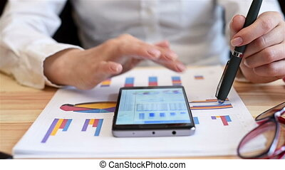 Woman Looking At Annual Sales Report - Trader Woman Looking...