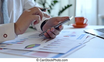 Trader Analyzing Income Charts And Graphs On Smartphone...