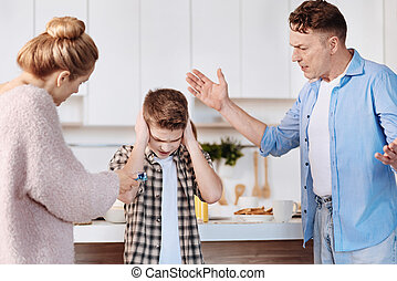 Caring parents scolding their son for smoking - Bad...