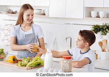 Cheerful siblings having a healthy breakfast