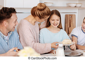 Loving mother taking care of her family in the kitchen