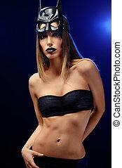 Beautiful woman wearing professional makeup and batman mask...