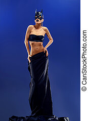 Gorgeous female fashion model wearing top and long black...