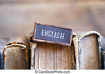 English, tag with the text written in it and books - English...