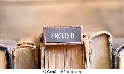 English, tag with the text written in it and books