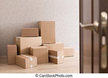Moving boxes pile in doorway