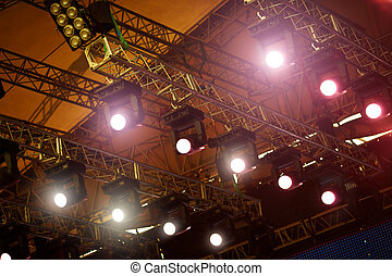 Stage Lights - a stage light rack with spotlights shining...