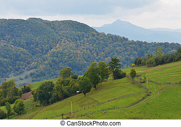 Mountain landscape on a cloudy day - Early autumn in a...
