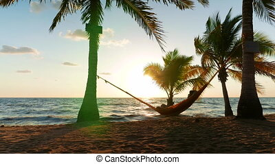 Sunrise Over Caribbean Sea - Caucasian man relaxing in a...