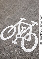 cycleway signal view - Bike lane sign painted on a street.