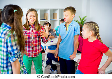 Kids discuss something - Group of friends are discussing...