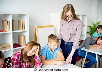 Teacher explaining something - A teacher is explaining...